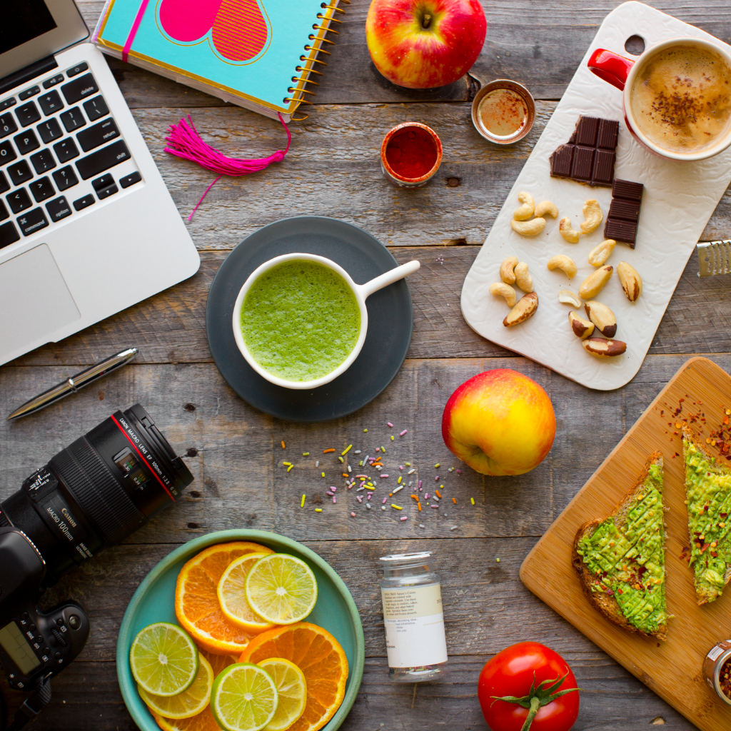 work from home creative spread laptop, camera, food