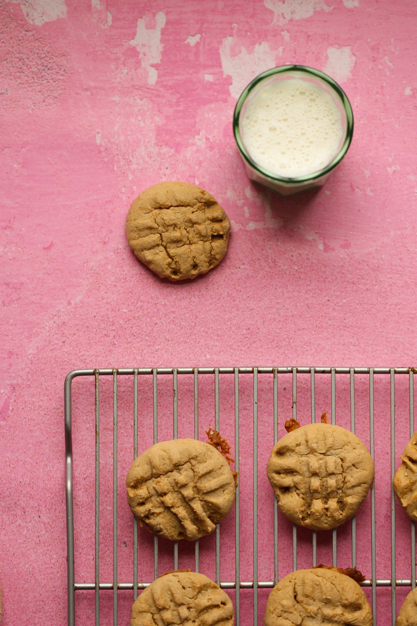 peanut butter cookies with milk and pink background