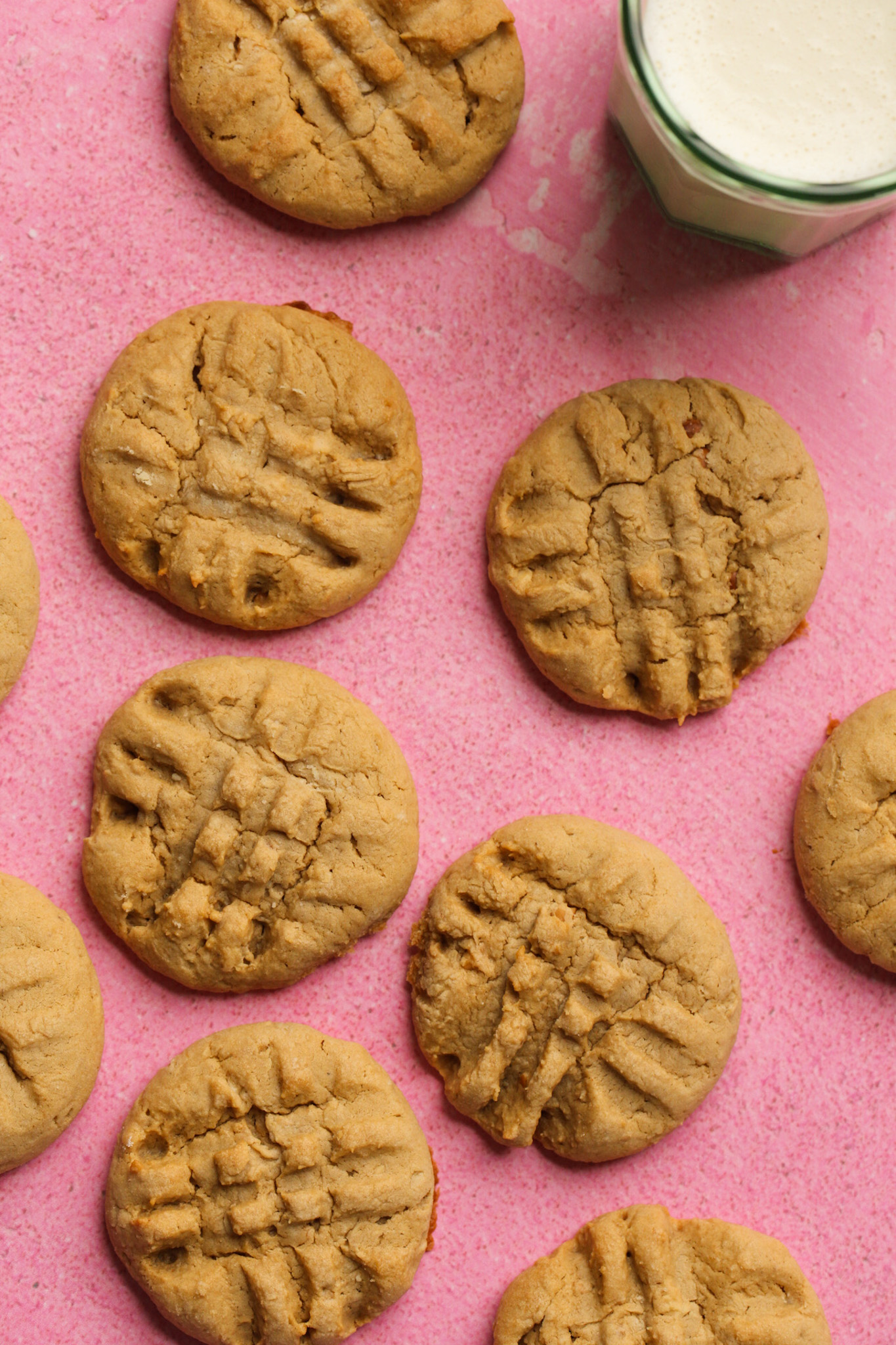 close up of peanut butter cookies on pink background