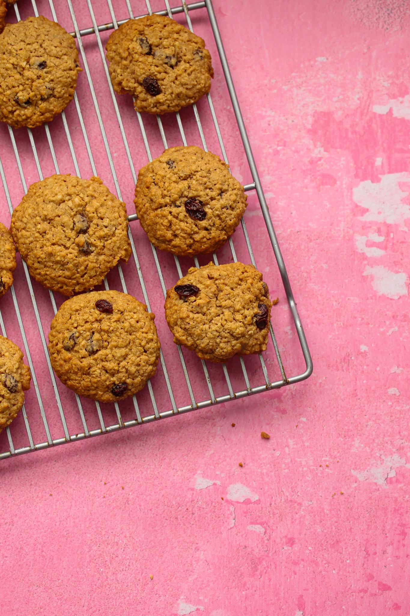 oatmeal raisin cookies on pink background