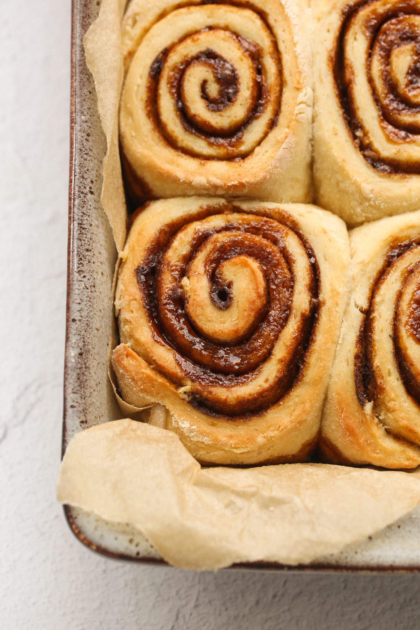 Baked, unfrosted cinnamon buns