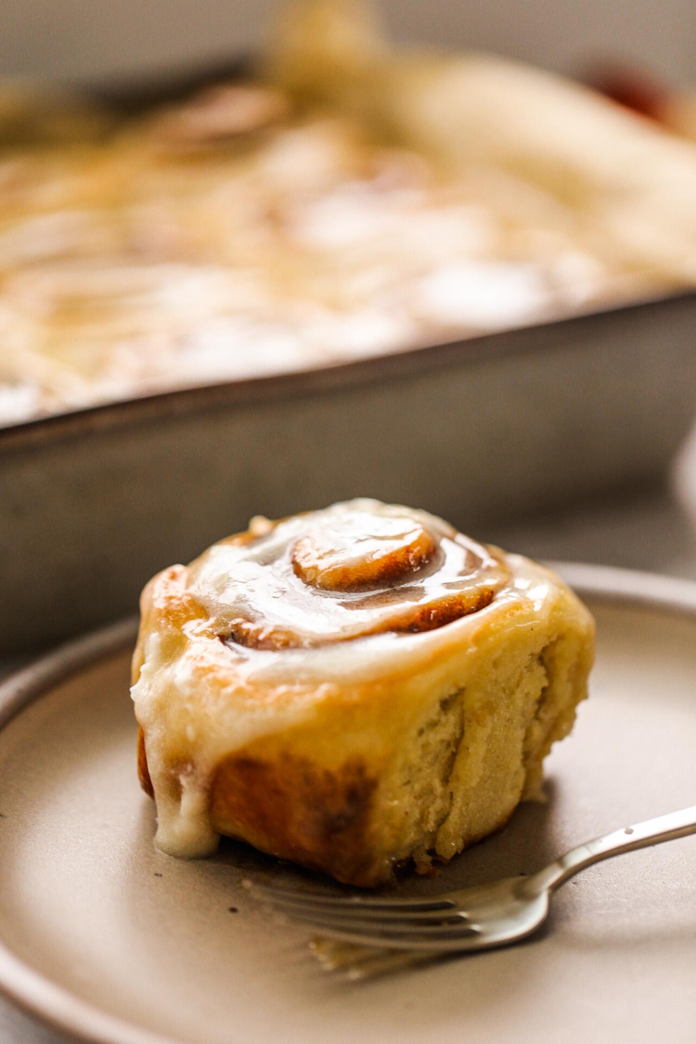 vegan cinnamon roll with glaze