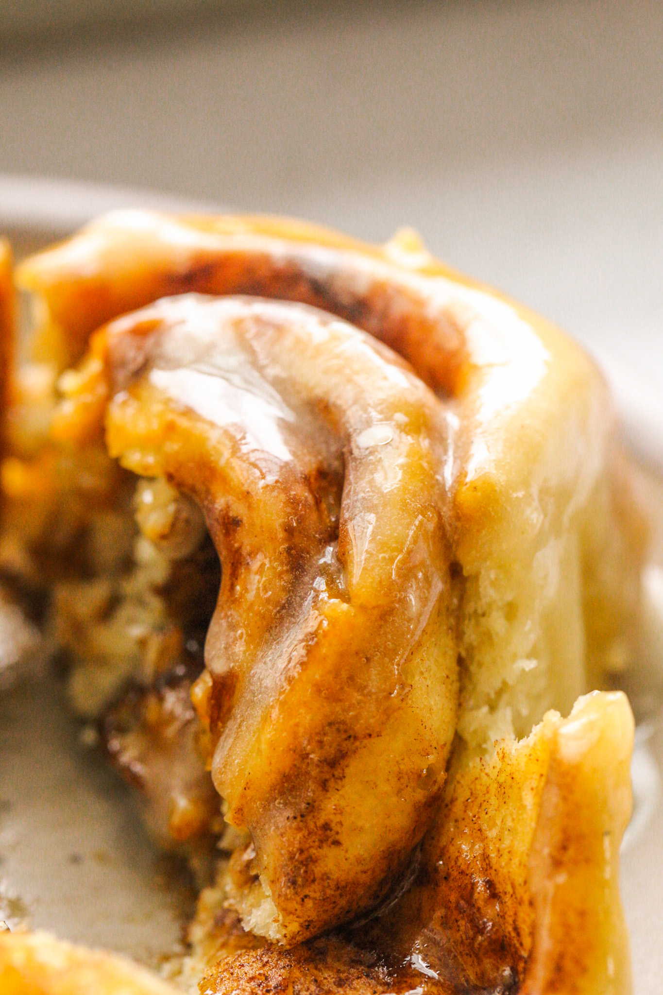 close up cinnamon roll glazed