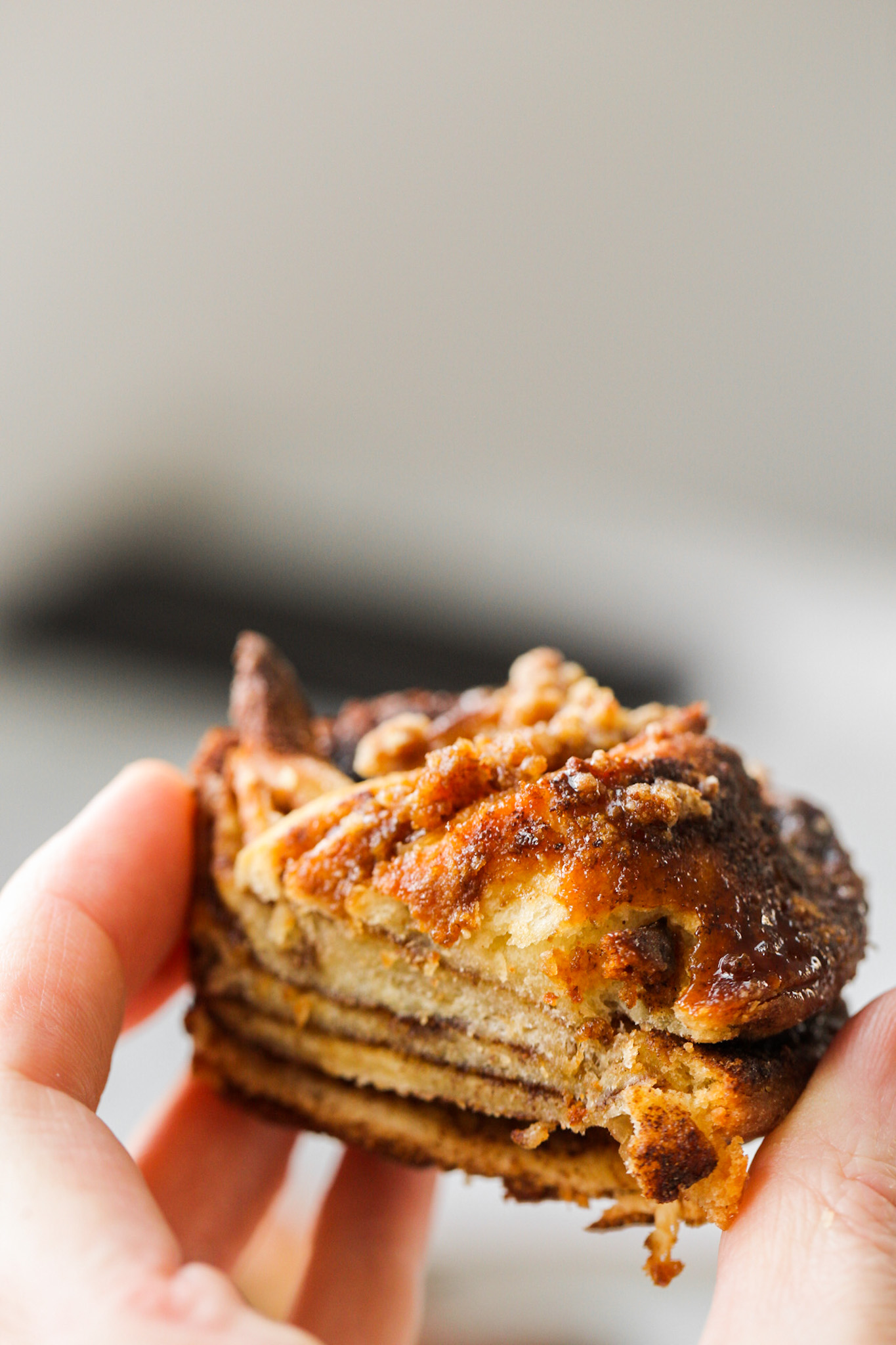 holding a mini babka sliced