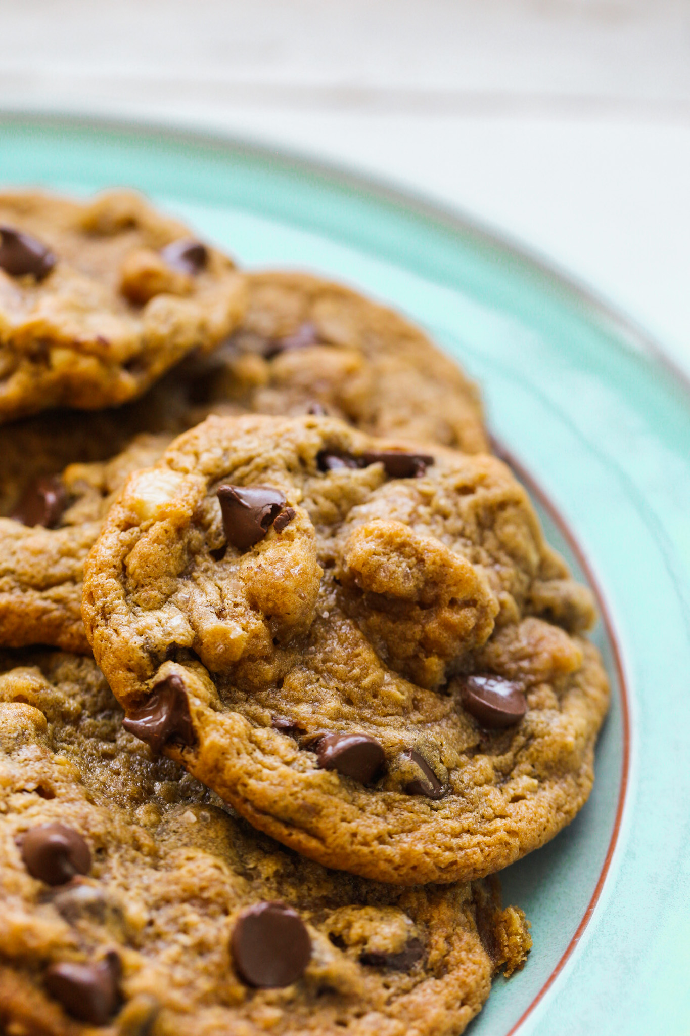 chewy chocolate chip cookies on teal plate