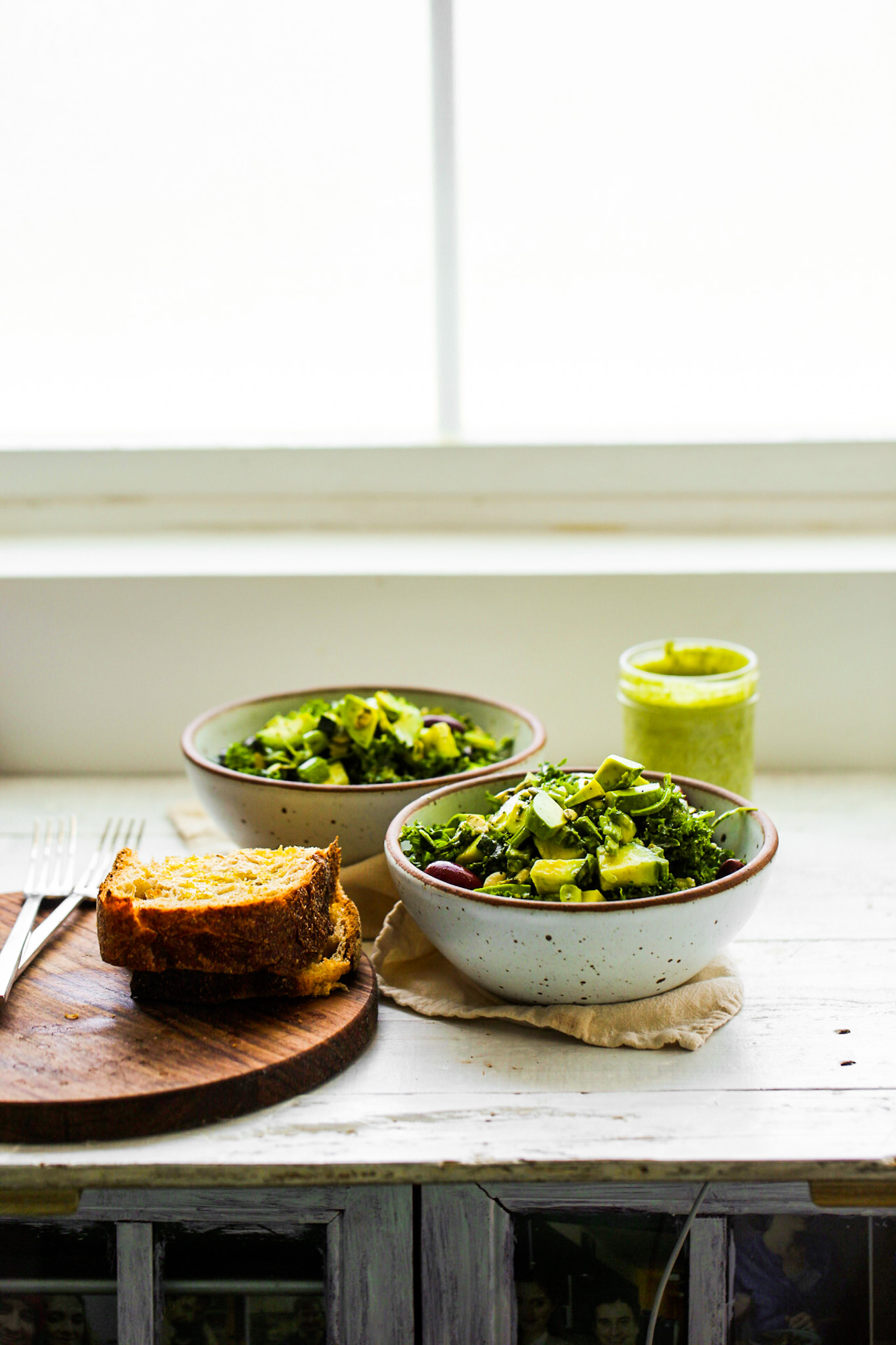 green goddess salad bowls with bread