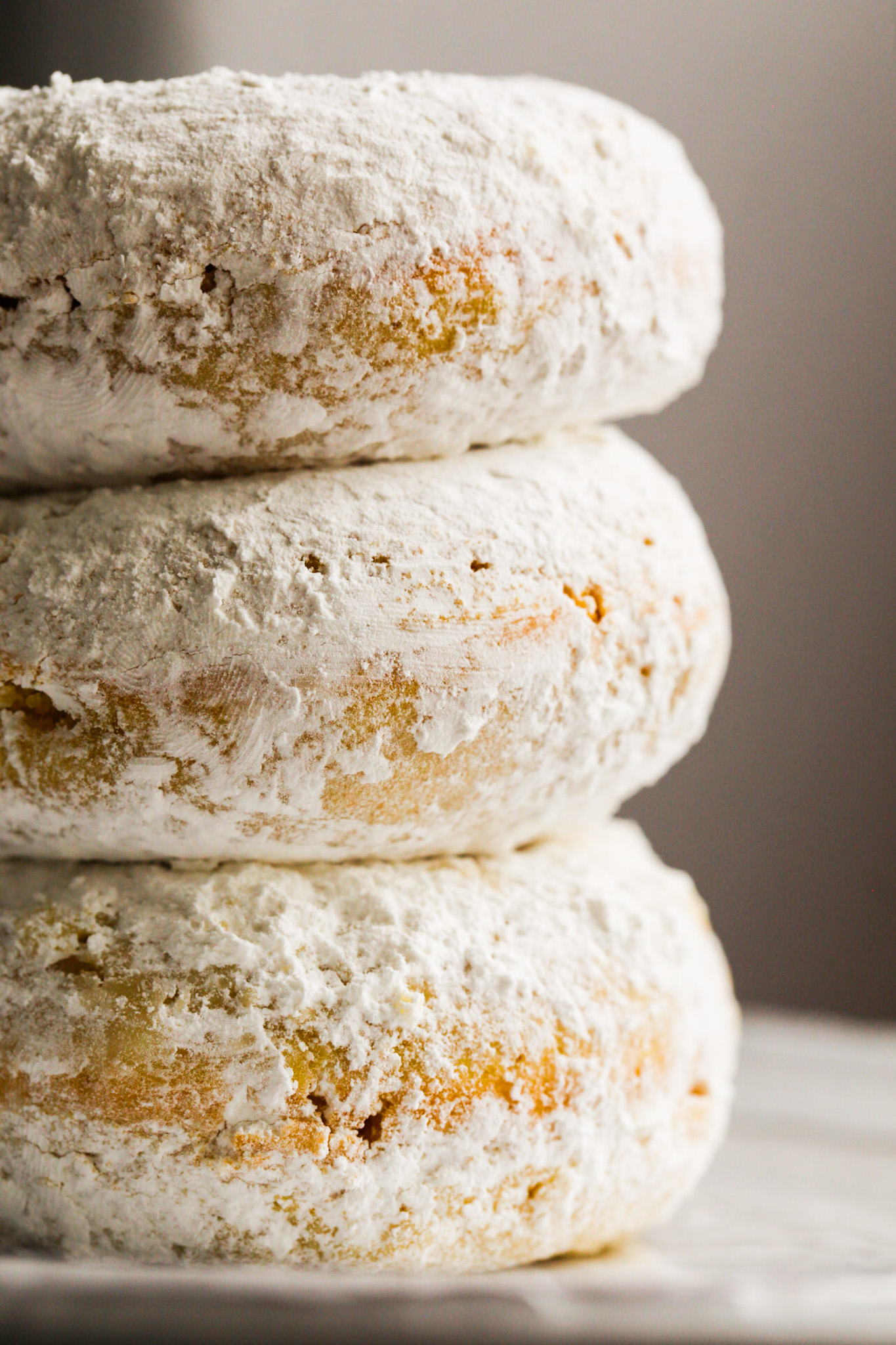 fluffy stack of powdered donuts
