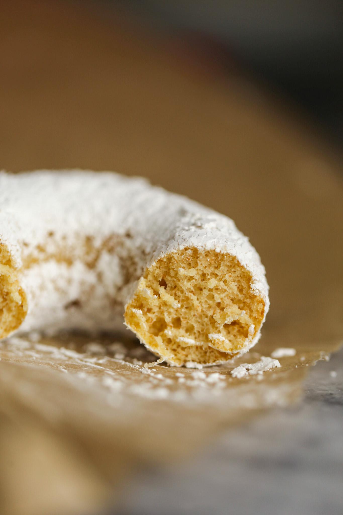 close up inside of powdered sugar donut