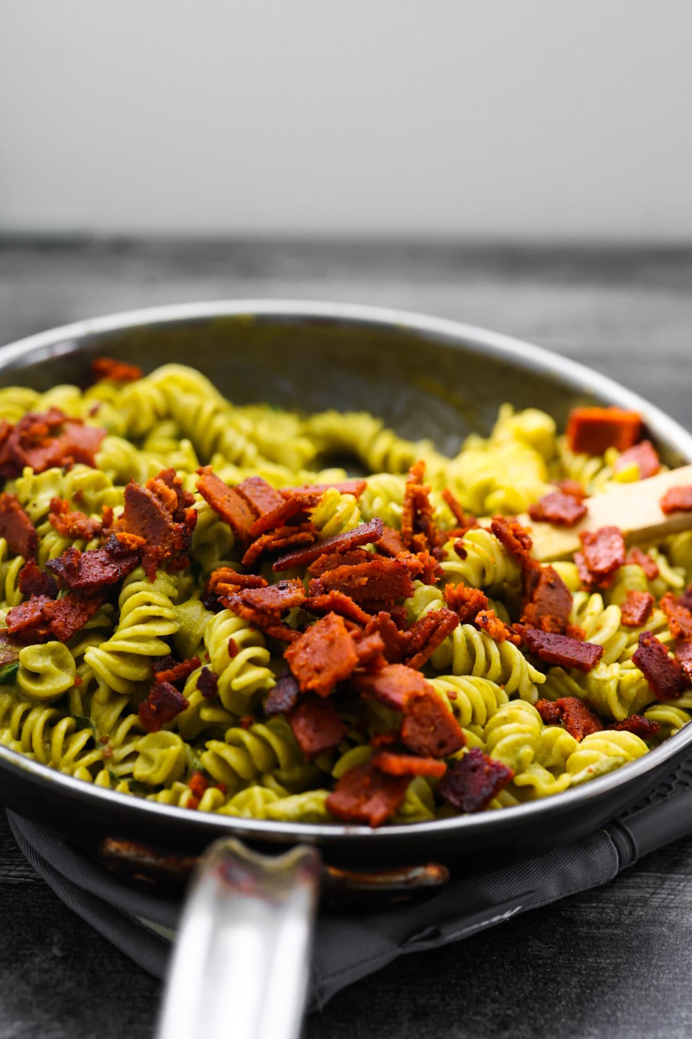 crispy vegan bacon on top pasta
