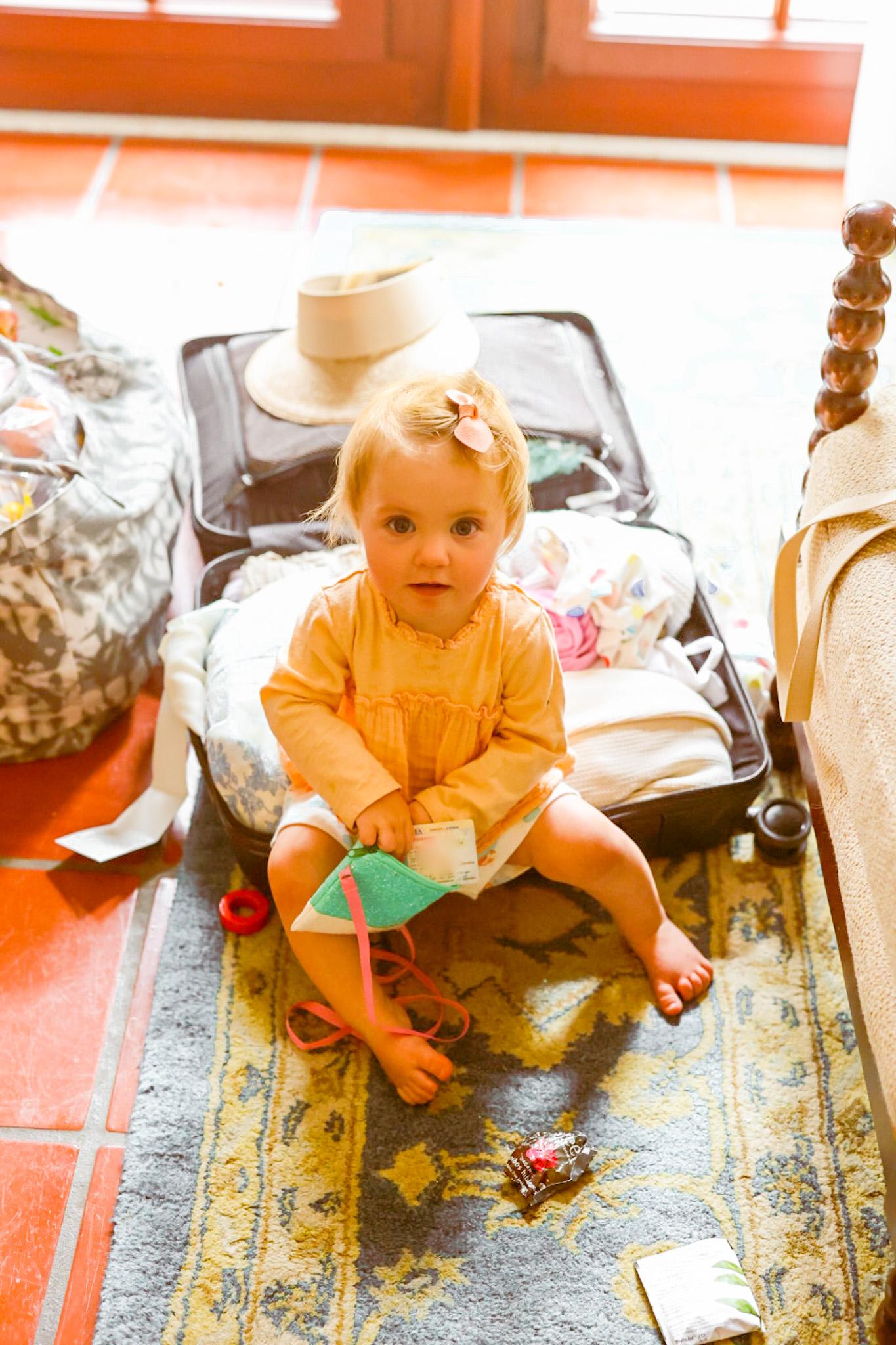 Rosalie baby road trip suitcase hotel floor