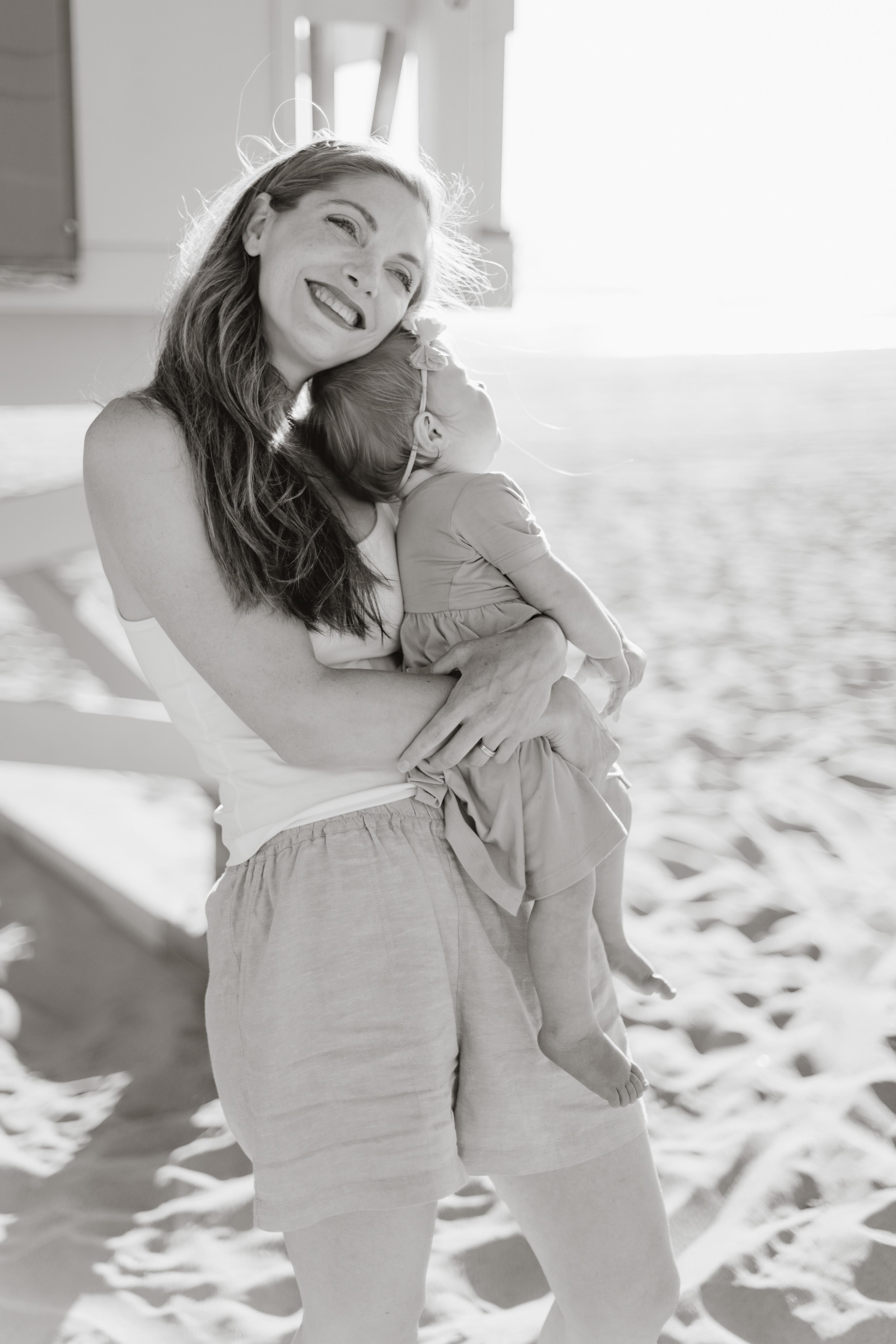 black and white mom baby on beach